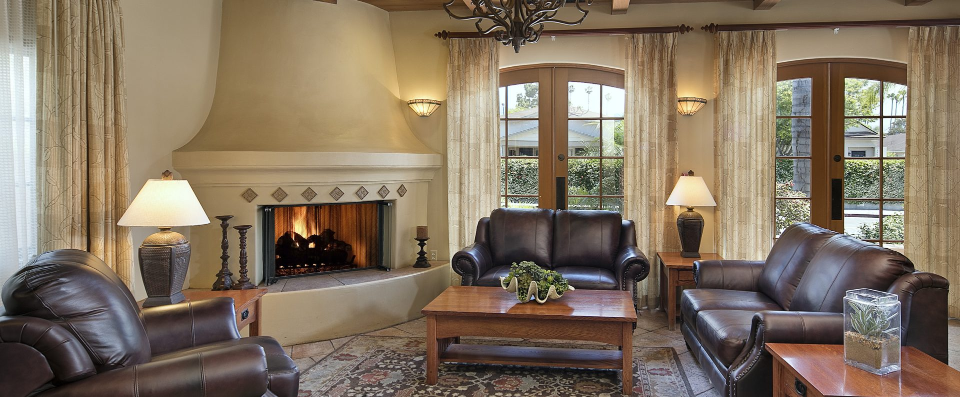 Room with cozy fireplace at Brisas del Mar, Inn at the Beach