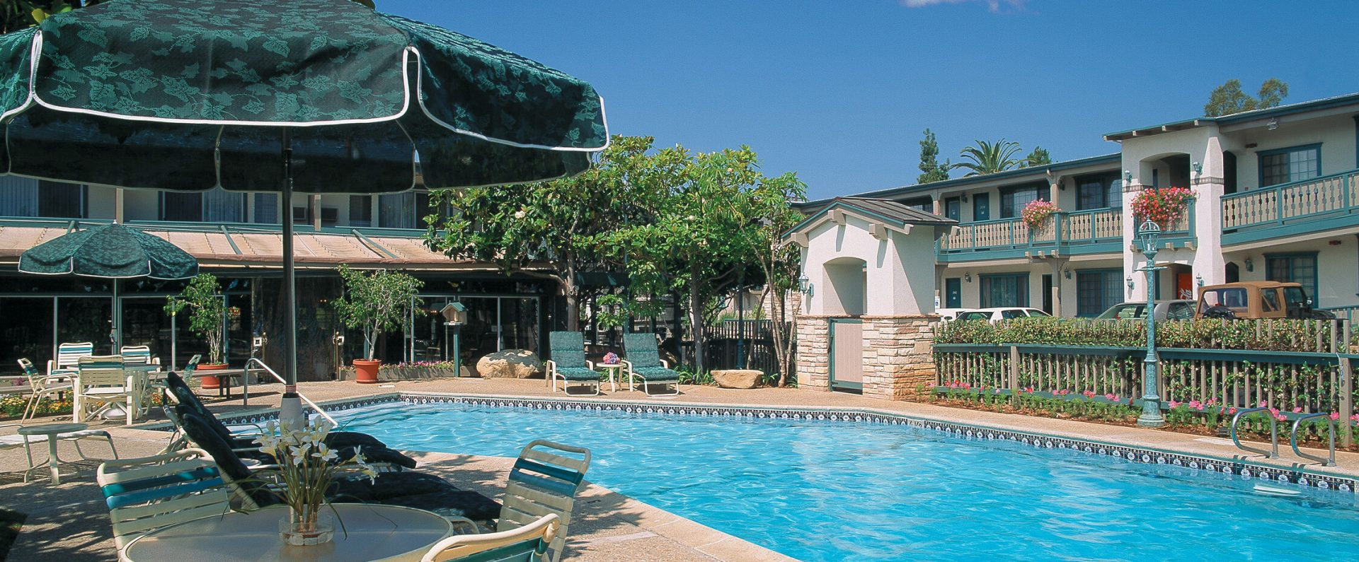Outdoor heated pool deck at Best Western Plus Encina Inn & Suites