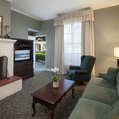 living room with fireplace at Lavender Inn by the Sea