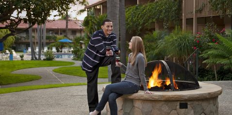 Cozy outdoor fireplace at Best Western Pepper Tree Inn