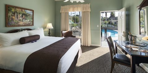 room with view of pool at Lavender Inn by the Sea