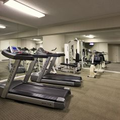 excersise room with various exercise equipment