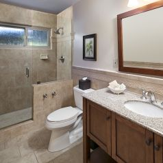 beautiful updated bathroom with walk in shower, and updated bathroom amenities