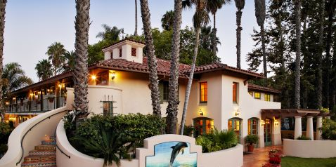 hotel exterior displaying Mediterranean style architecture with water fountain featuring dolphin statue