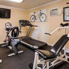 exercise room with a variety of work out equipment